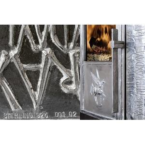 Teplovzdušná krbová kamna Iron Dog 05 - umělecké dílo, které potěší každého milovníka krásných výtvorů a zároveň zahřeje