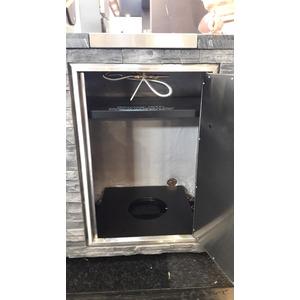 Venkovní grilovací kuchyně GrandHall STONE ISLAND OUTDOOR KITCHEN - detail skříňky pro plynovou láhev